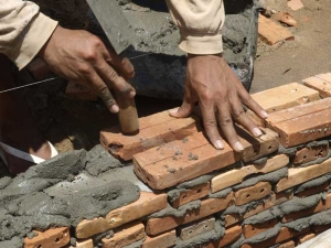The first bricks being laid