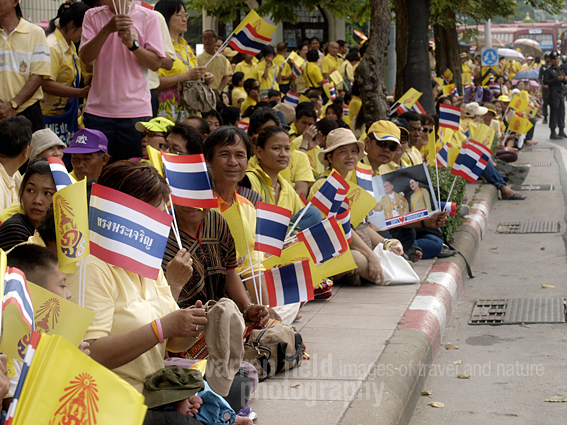 Adoring crowds await the arrival of King Bhumibol.