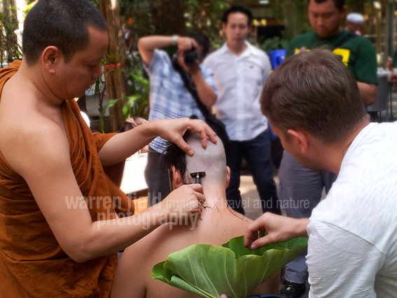 Goodbye hair (and eyebrows). Removing attachments to worldly (and bodily) possessions prepares a soon-to-be novice monk life in the robes.