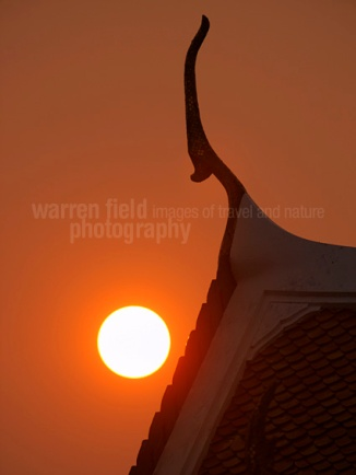 Setting sun at Loha Prasat, Bangkok, Thailand