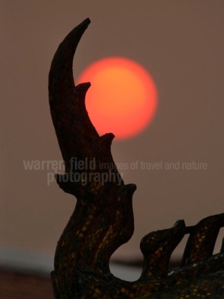 Temple detail in setting sun at Loha Prasat, Bangkok, Thailand